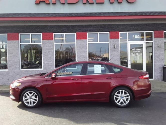 2013 RED FORD FUSION SE (3FA6P0HR9DR) with an 1.6L engine, Automatic transmission, located at 3100 Covert Avenue, Evansville, IN, 47714, (812) 473-4492, 37.955418, -87.512238 - Photo #0