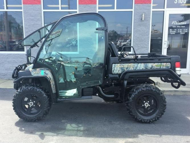 2012 CAMO JOHN DEERE GATOR XUV 825I mileage is # hours (1M0825GSLCM) with an 4 ST engine, Automatic transmission, located at 3100 Covert Avenue, Evansville, IN, 47714, (812) 473-4492, 37.955418, -87.512238 - Photo #0